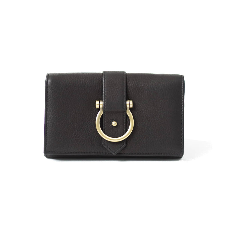The Staney in black raw leather is a minimal wallet, wristlet, belt bag, and crossbody bag all in one.