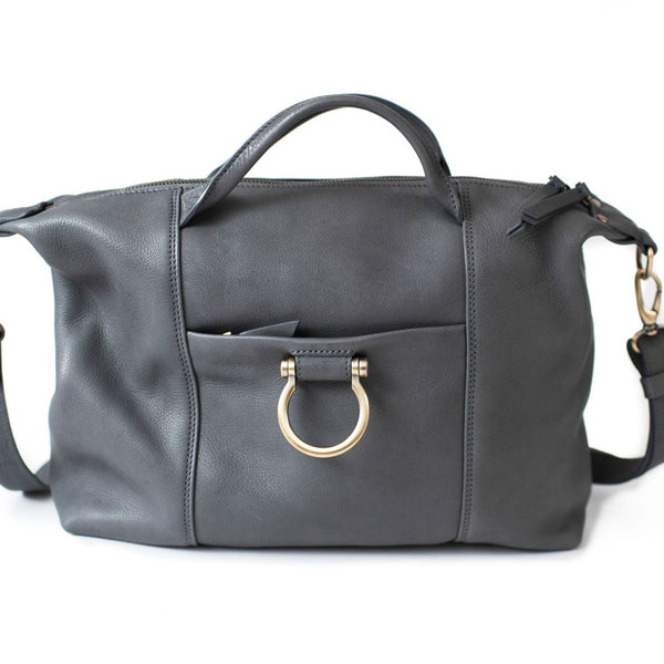 Linda Jean: large handbag in gray raw leather with top zip, removable strap, and exterior zippered pocket.