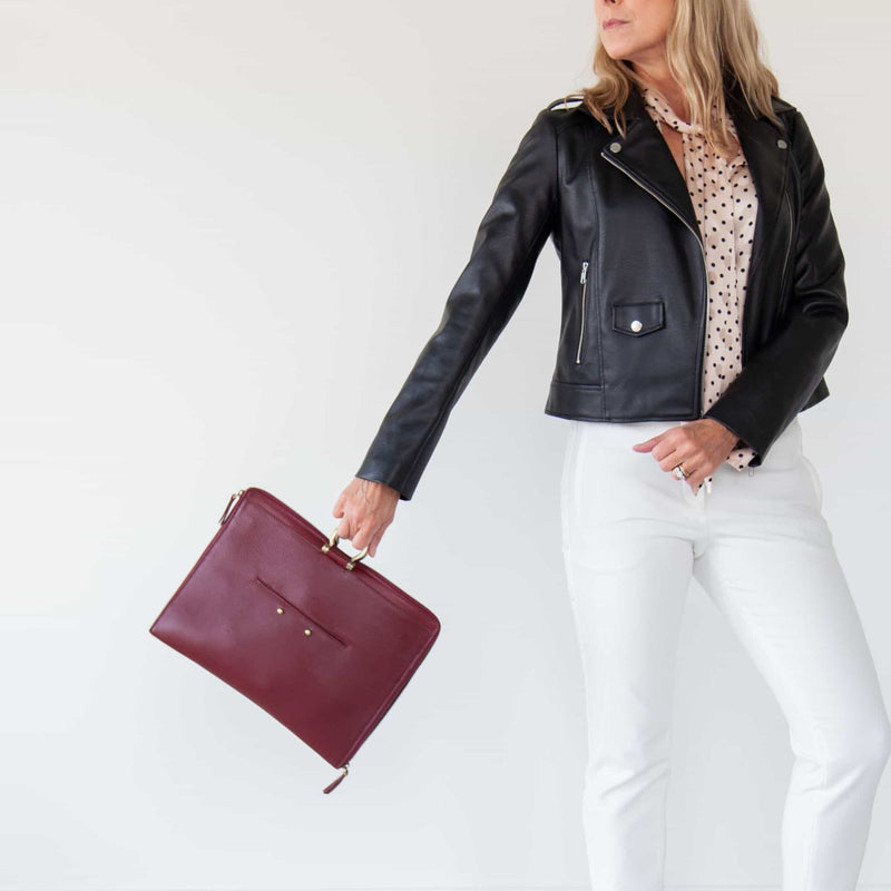 Carry the M large crossbody bag in deep red oil leather by the Omega hardware for an elevated look.