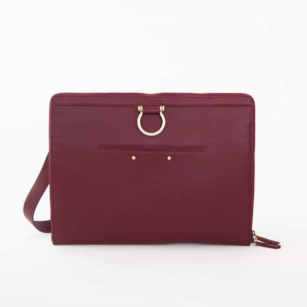 The M large crossbody bag in deep red oil leather has a zip enclosure, front exterior pocket, and Omega hardware.