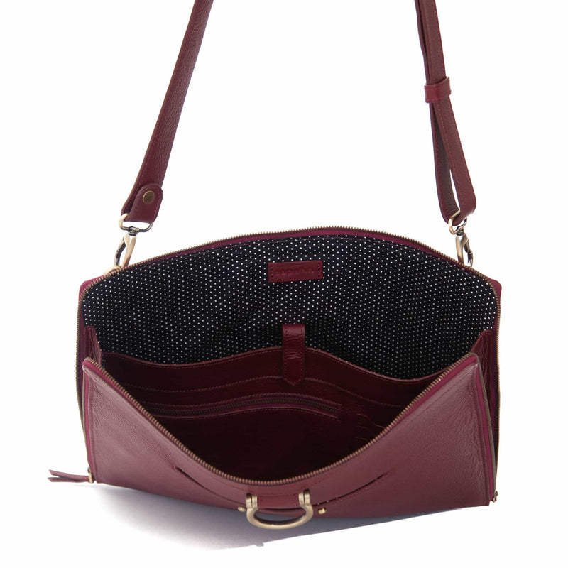 "The M large crossbody bag in deep red oil leather will hold your 13"" laptop in a scratch-resistant interior sleeve."