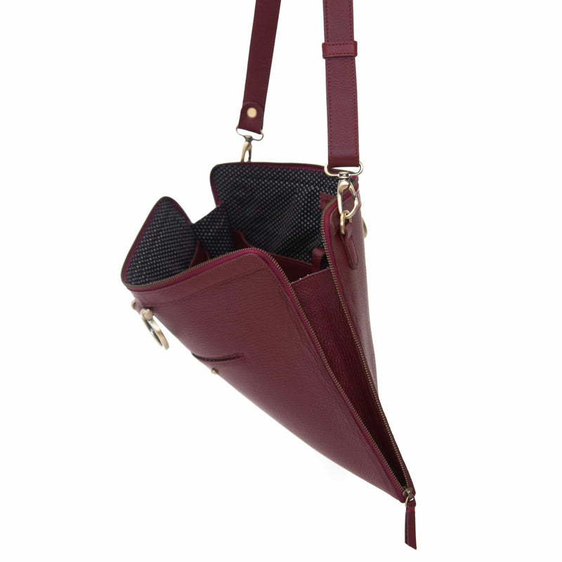 The M large crossbody bag in deep red oil leather zips all the way around for a sleek, minimalist look.