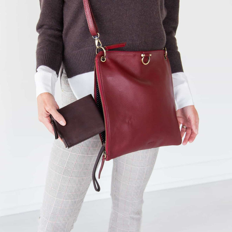 The Noelle billfold wristlet wallet in chocolate brown raw leather fits perfectly in small and medium-sized bags.