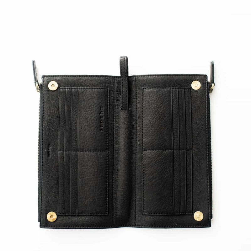 Lay the Parker deluxe wristlet wallet in black raw leather flat to see all 16 card slots at once.