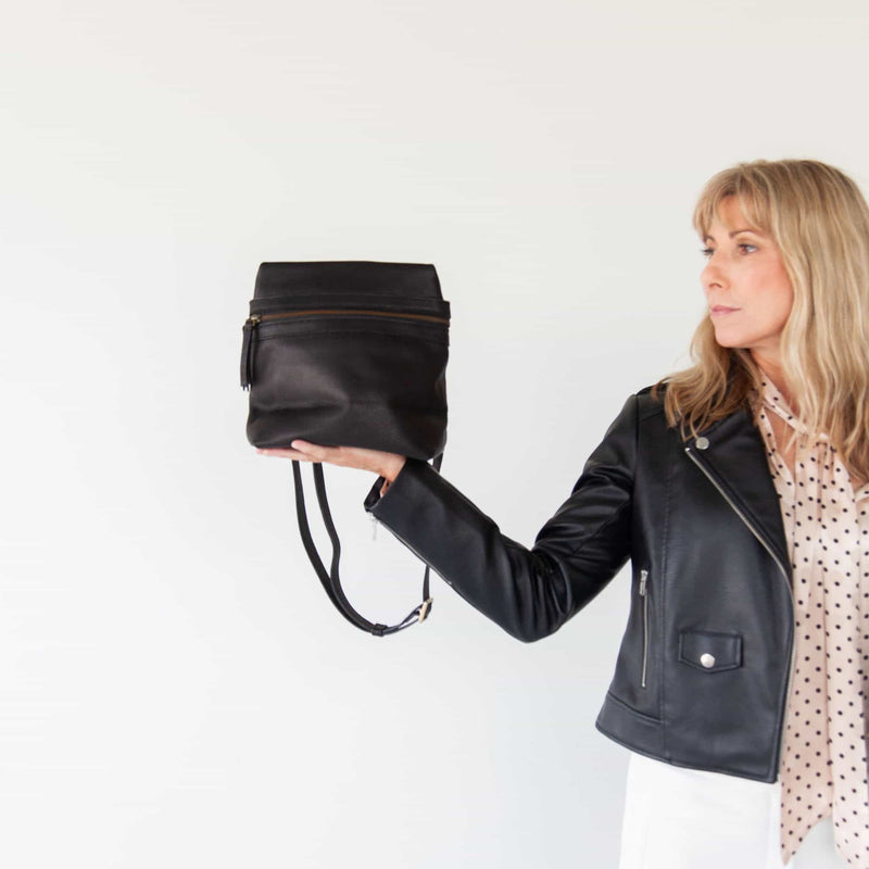 The Pepper convertible backpack in black raw leather is the perfect small to medium-sized bag.