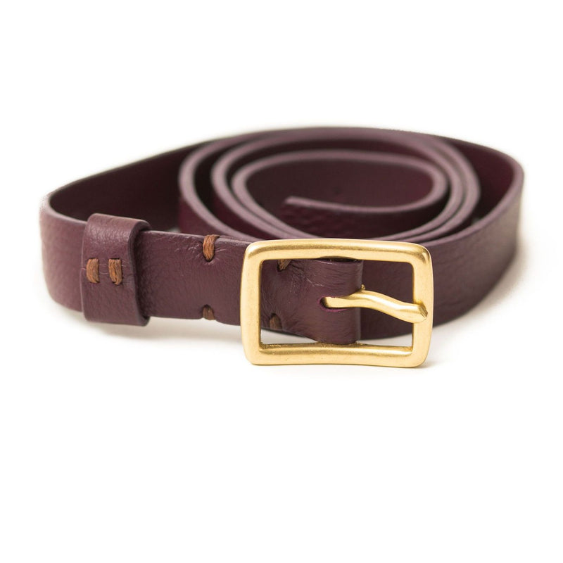The Rosa belt in biking red oil leather is a classic style with a brass belt buckle.