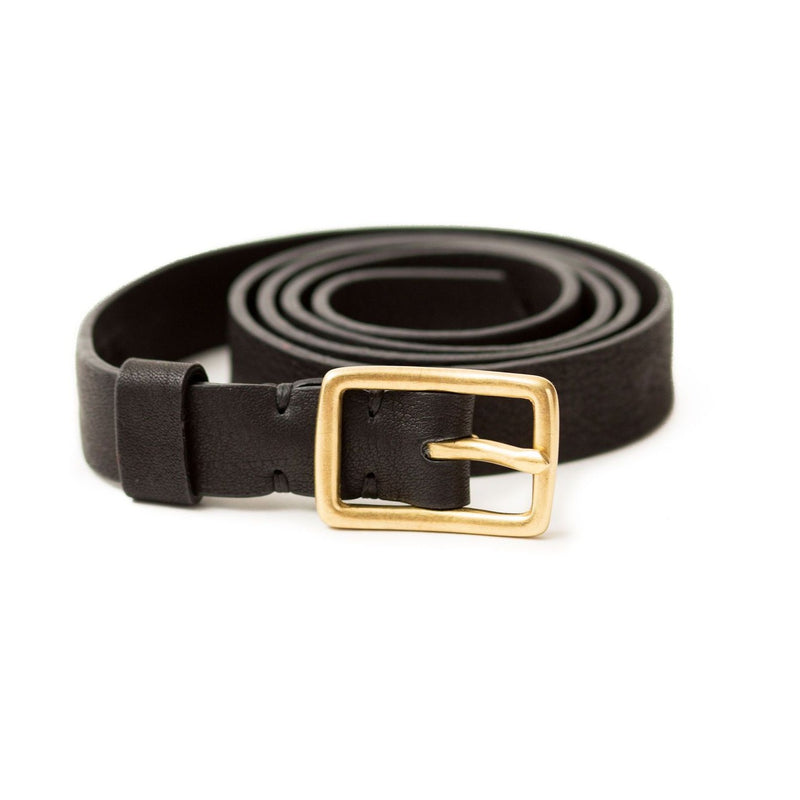 The Rosa belt in black raw leather is a classic style with a brass belt buckle.