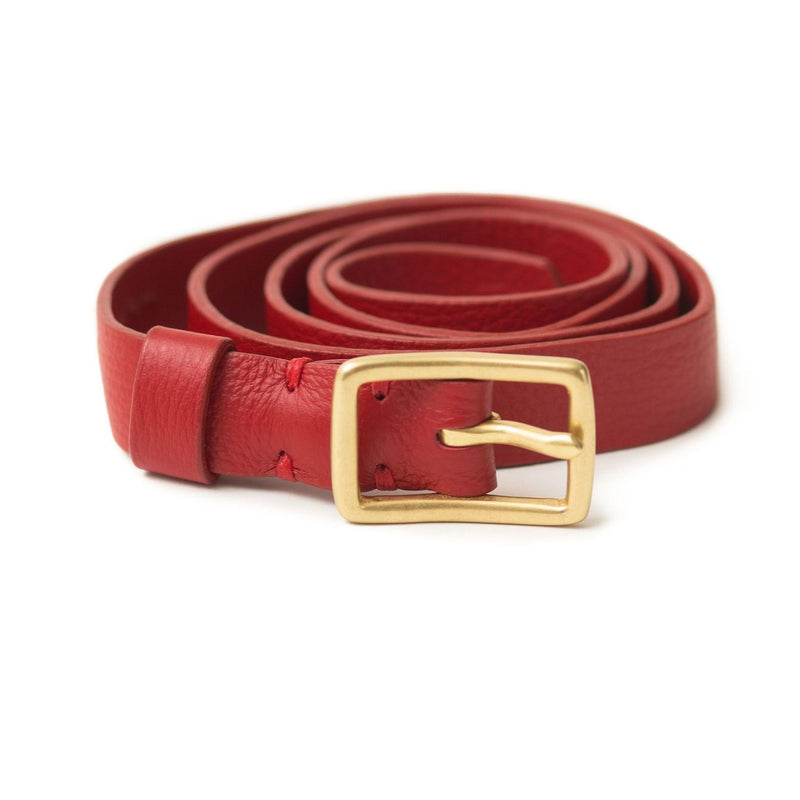The Rosa belt in chili pepper red oil leather is a classic style with a brass belt buckle.