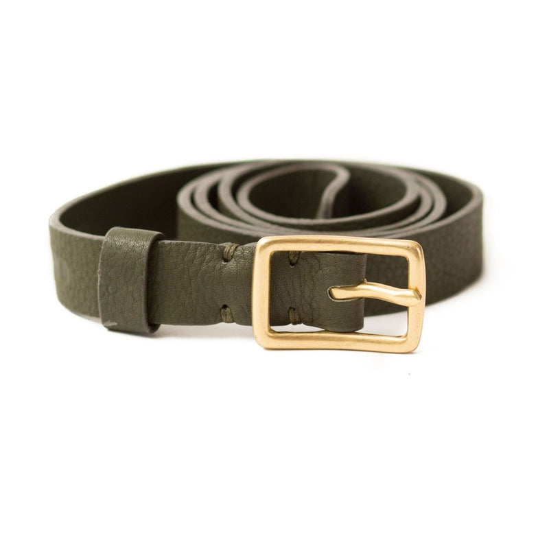 The Rosa belt in olive green raw leather is a classic style with a brass belt buckle.