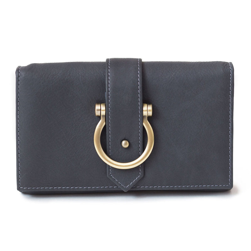 The Staney in gray raw leather is a minimal wallet, wristlet, belt bag, and crossbody bag all in one.