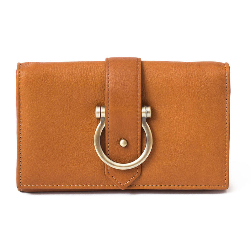 The Staney in whisky tan raw leather is a minimal wallet, wristlet, belt bag, and crossbody bag all in one.