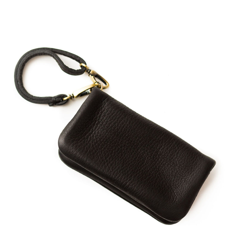 The Woo card holder in black raw leather is sleek and minimal and can be used as a wallet, wristlet, or keychain addition.