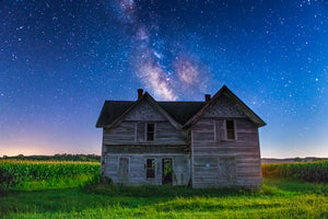 Abandoned home at night with the Milky Way Galaxy in the night sky near Mondovi, Wisconsin.