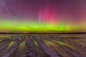 Northern Lights on a frozen lake in the winter near Gilman, Wisconsin.