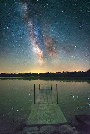 Milky Way Galaxy vertically aligned with dock at Coon Fork County Park in Wisconsin.