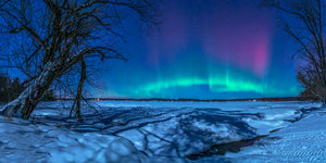 Northern Lights in the winter over frozen Tainter Lake in Wisconsin.