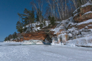 Ice caves in the full moonlight at the Apostle Island National Lakeshore near Cornucopia, Wisconsin.