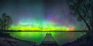 Dock and a lake at night with Northern Lights in the sky near Gilman, Wisconsin.