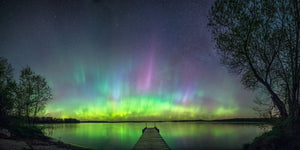 Northern Lights over a dock on a lake near Gilman, Wisconsin.