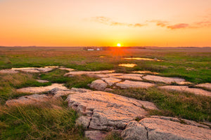 Sunset at Touch The Sky Prairie, overlooking the prairie and a rock formation near Luverne, Minnesota.