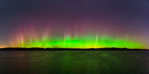 Panoramic view of the Northern Lights over the Biron Flowage in Wisconsin Rapids, Wisconsin.