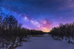 Milky Way Galaxy over frozen Eau Claire River on County Road G bridge near Augusta, Wisconsin.