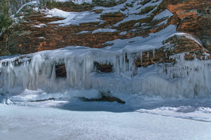 Ice caves in full moon light at Apostle Island National Lakeshore near Cornucopia, Wisconsin.