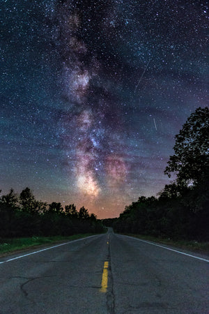 Milky Way Galaxy hovering over road near Fall Creek, Wisconsin.