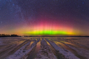Northern Lights over a frozen lake with ice and snow near Gilman, Wisconsin.