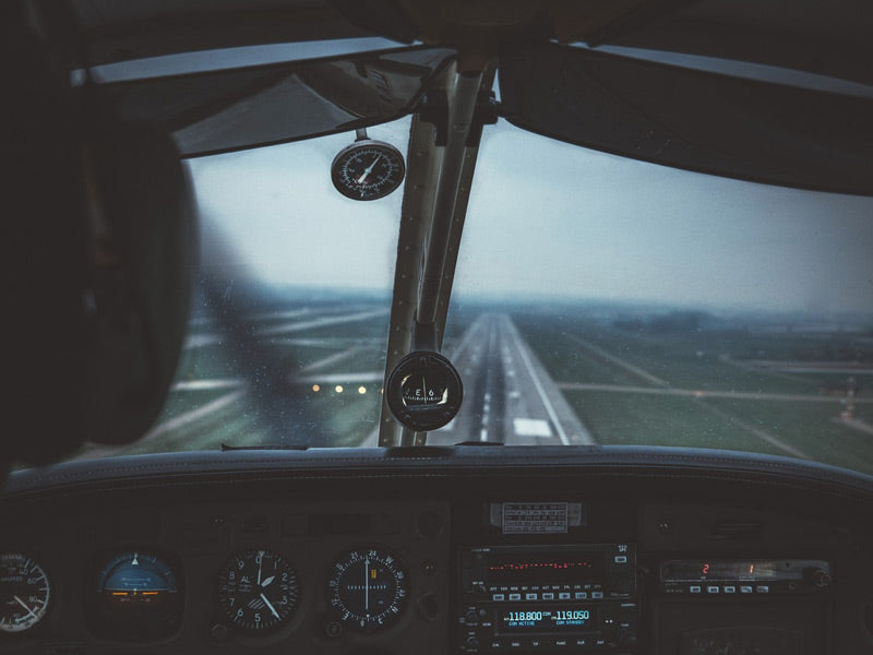 picture of cockpit and a runway