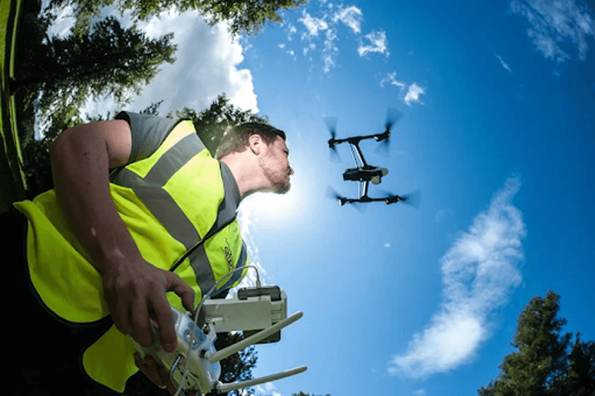 Person flying a drone in hot weather
