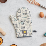 A cream coloured oven mitt beautifully illustrated with iconic kitchen utensils such a cake mixer, wooden spoons and spatulas.