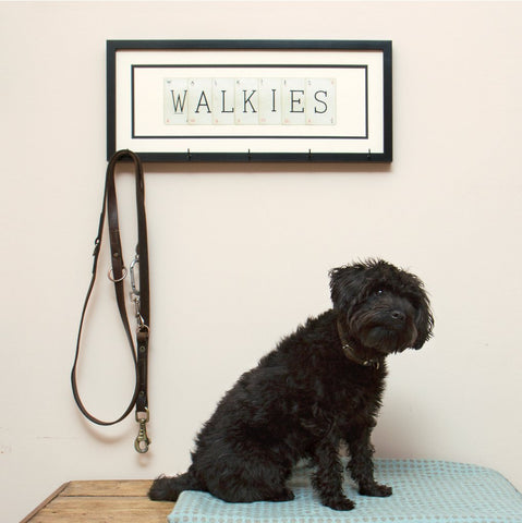 Unique wall art using original vintage playing cards to spell out the word 'walkies'