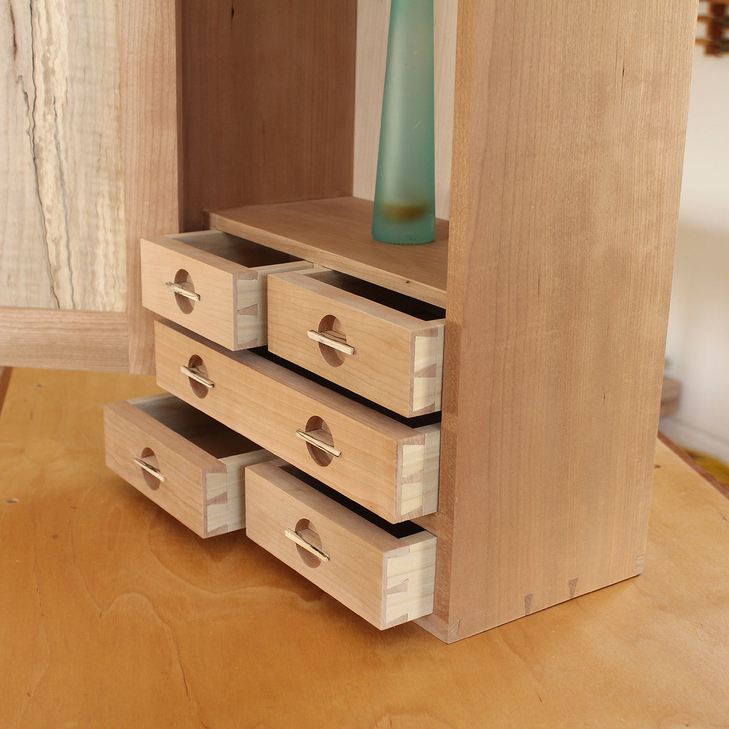 Wall Cabinet drawers with unique, recessed pulls
