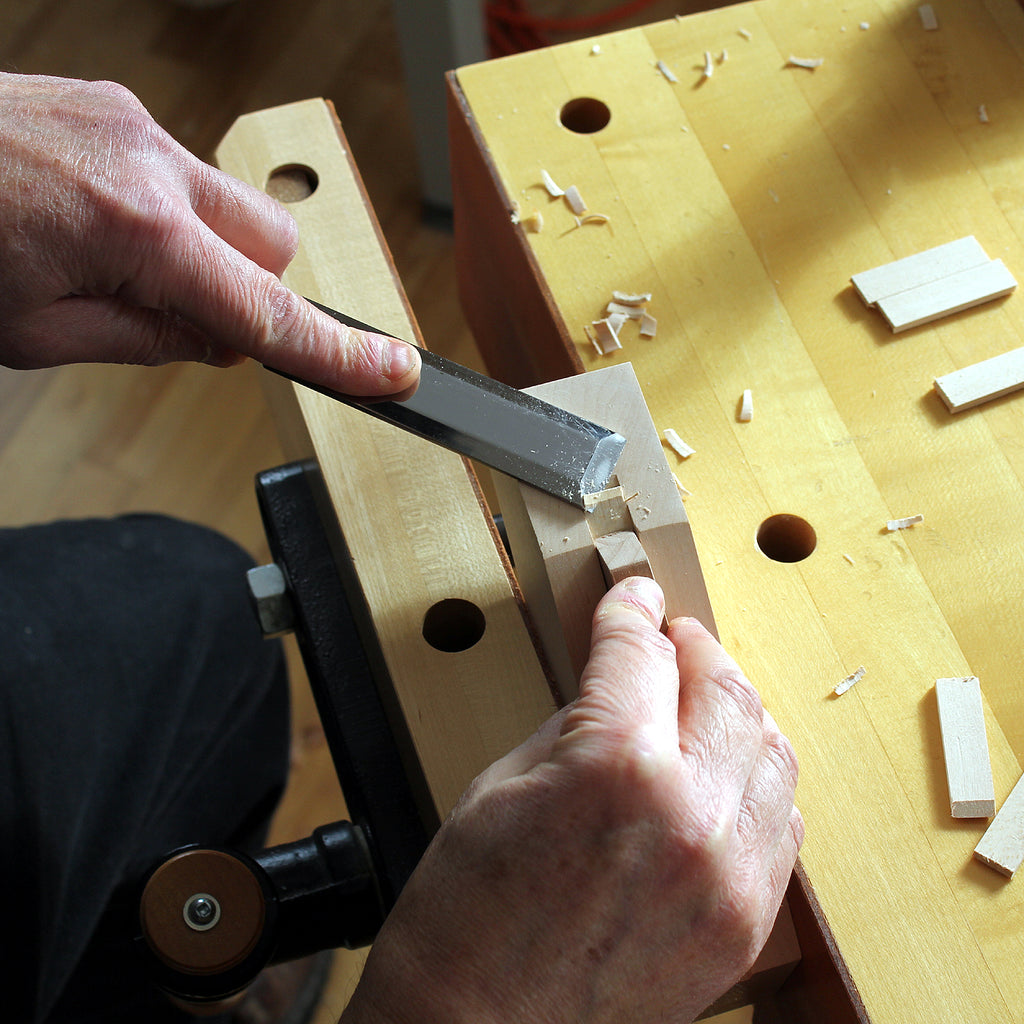 paring kumiko pieces using a chisel and guide block