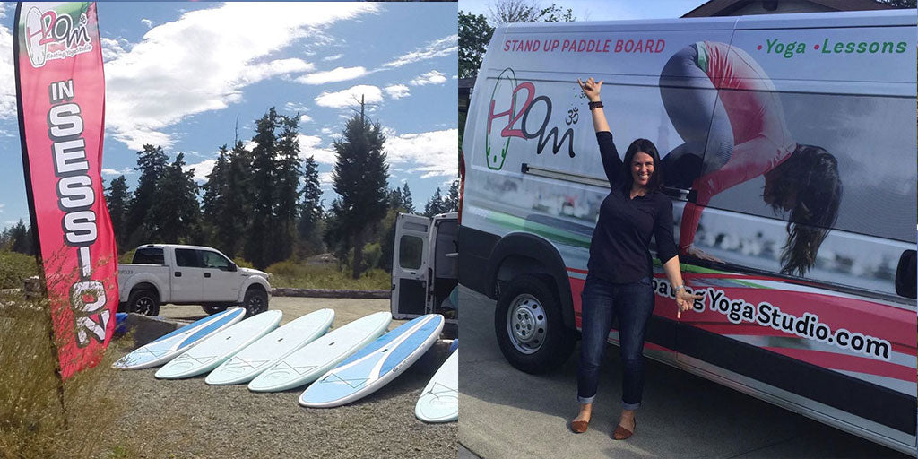 SUP Boards laying on the beach in front of Stand Up Paddle Board rental van.