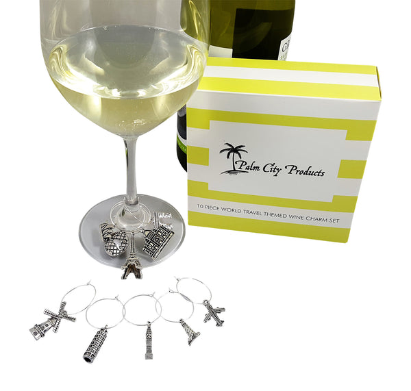 Travel Themed Wine Charms on glass of chardonnay with box and bottle next to it