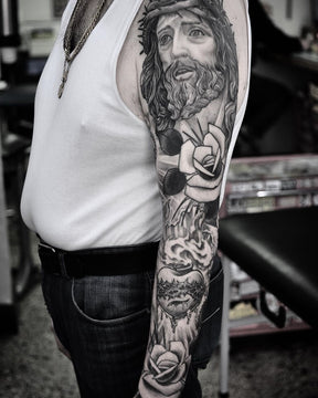 Black and Grey Religious Full Sleeve Tattoo By Pablo Morte