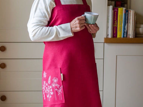 Kitchen Apron in raspberry linen. Handmade in Cornwall using 100% natural linen.