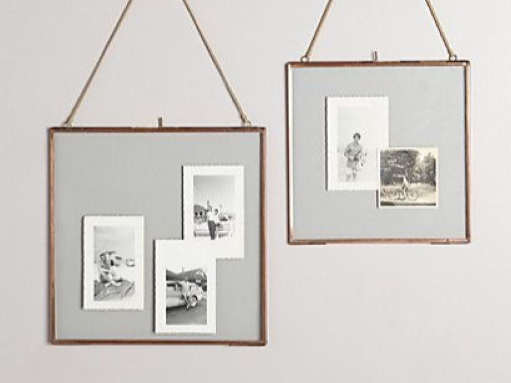 Add a vintage touch to your living room with these elegant Brass picture frames with glass casing.