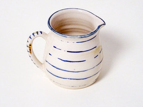 Bring a provincial feel to your kitchen with this large striped handmade ceramic pouring jug. Handmade in Cornwall by Laetitia Miles.