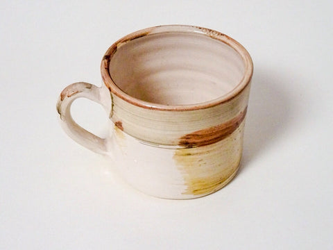 Add a rustic touch to your tea with this handthrown ceramic mug from Cornish artist Laetitia Miles.
