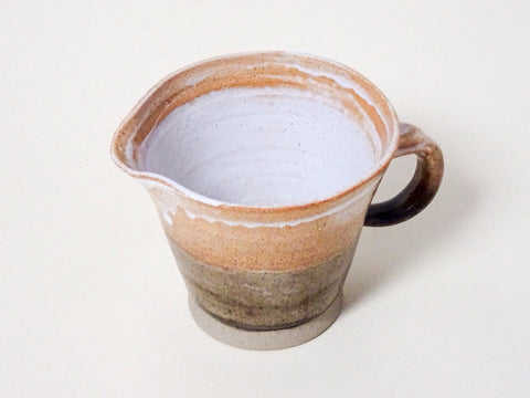 A lovely rustic Handthrown ceramic pouring jug from Cornish artist J.Carter.