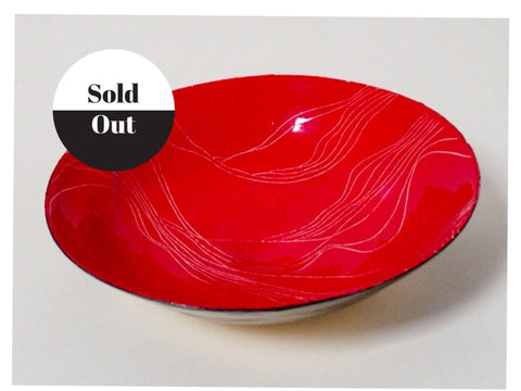 Beautiful hand painted red ceramic bowl. Great as a colourful decorative piece.