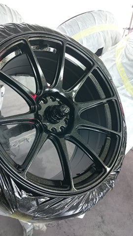 evo 8 gsr alloys being painted