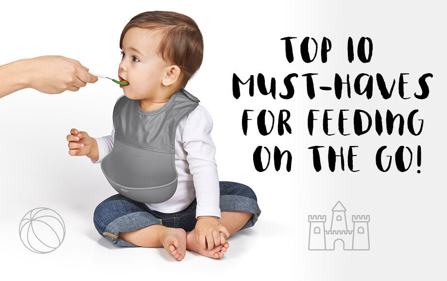 Mum feeding son with one of the Top 10 Must-Haves For Feeding On The Go