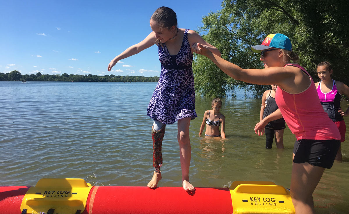 Kids Gain Confidence Through Log Rolling at Therapeutic Recreation Camp