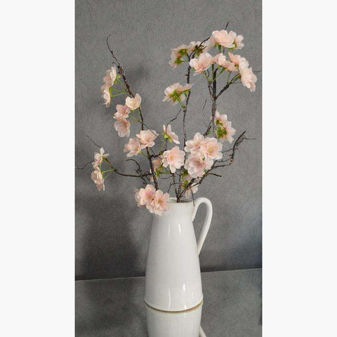 Pale Pink Blossom Branch in a Ceramic Jug