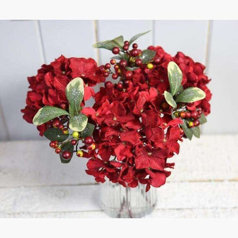 Heads of Red Velvet Hydrangeas, Mixed Berries and Icy Foliage In Ribbed Glass Vase, Set in Faux Water