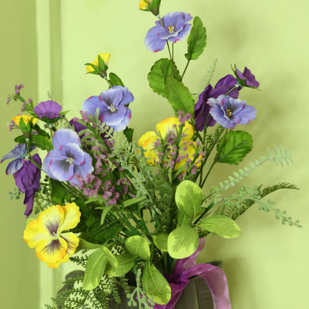 Purple and Pale Lavender Mixed Yellow Pansies in a Tied Bouquet